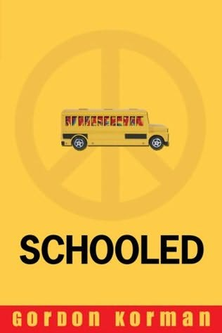 A yellow schoolbus with rainbow tie-dyed windows is shown sideways over a large peace sign on a yellow cover